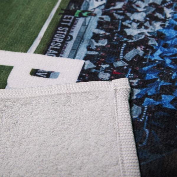 detaljbild på badlakan med motiv av tifot från IFK Norrköping mot AIK under Allsvenskan 2019